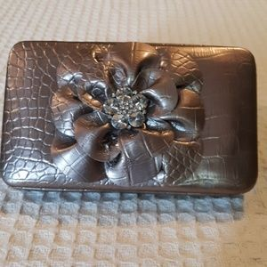 Very pretty clutch bag not sure of the brand & age